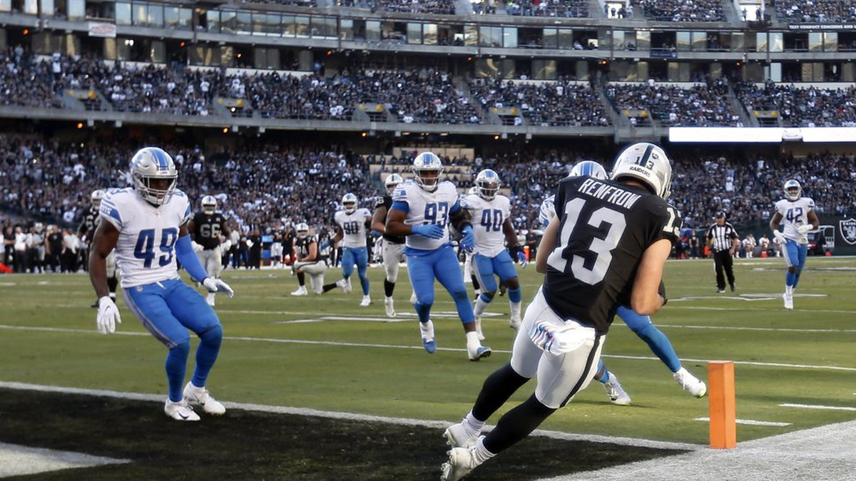 Oakland Raiders wide receiver Hunter Renfrow (13) catches a touchdown pass against the Detroit...