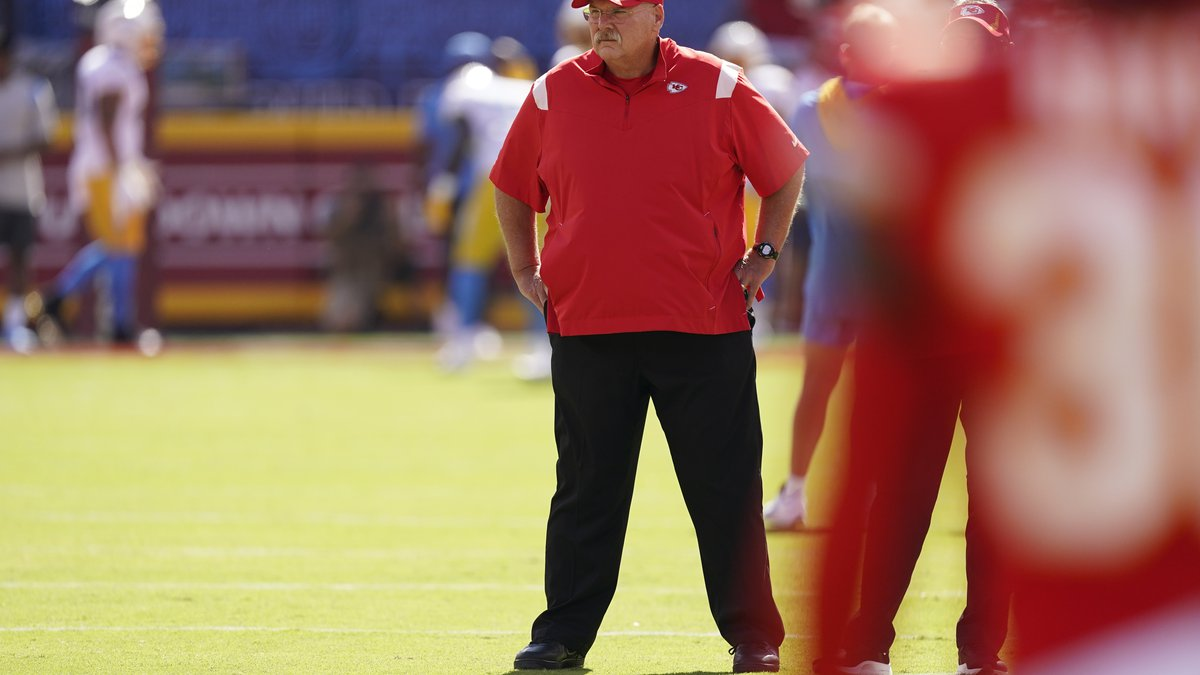 Kansas City Chiefs head coach Andy Reid watches as the teams warms-up before an NFL football...