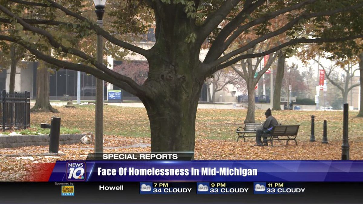 A homeless man sits in Reutter Park in downtown Lansing on a cold November morning. (WILX)