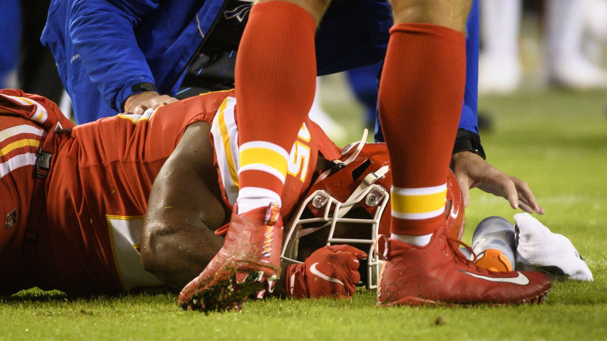 Kansas City Chiefs running back Clyde Edwards-Helaire lies on the ground after being injured...