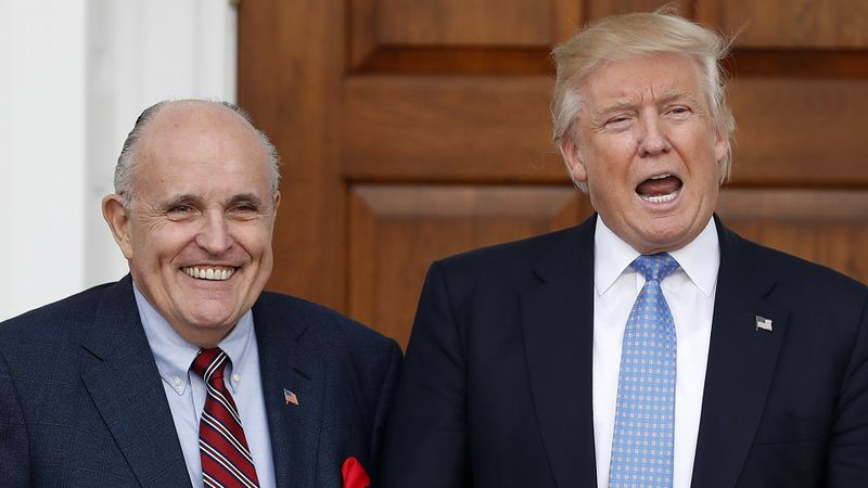 President-elect Donald Trump calls out to media as he and former New York Mayor Rudy Giuliani...