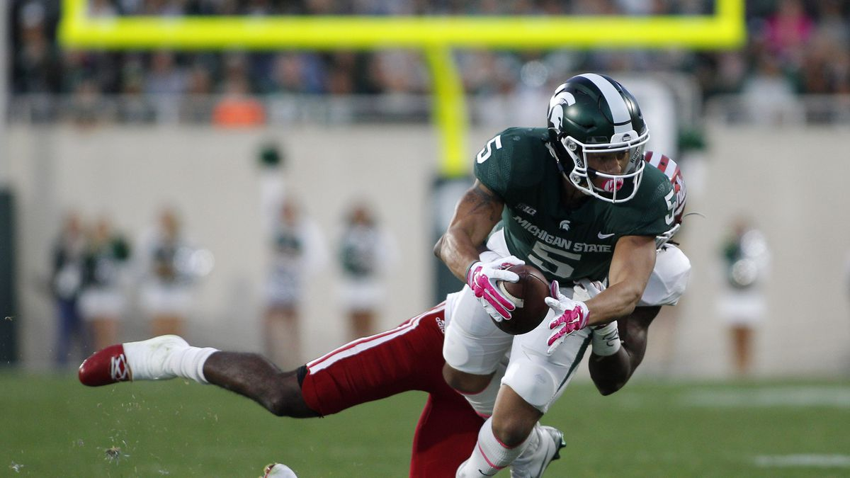 Michigan State receiver Hunter Rison (5) catches a pass against Indiana's Jonathan Crawford during an NCAA college football game, Saturday, Oct. 21, 2017, in East Lansing, Mich. Michigan State won 17-9. (AP Photo/Al Goldis)