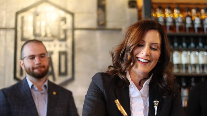 Gov. Gretchen Whitmer signs a package of bills.