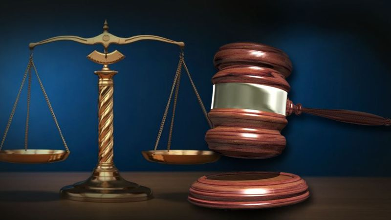 Two Lansing men sentenced to federal prison for armed robbery spree.