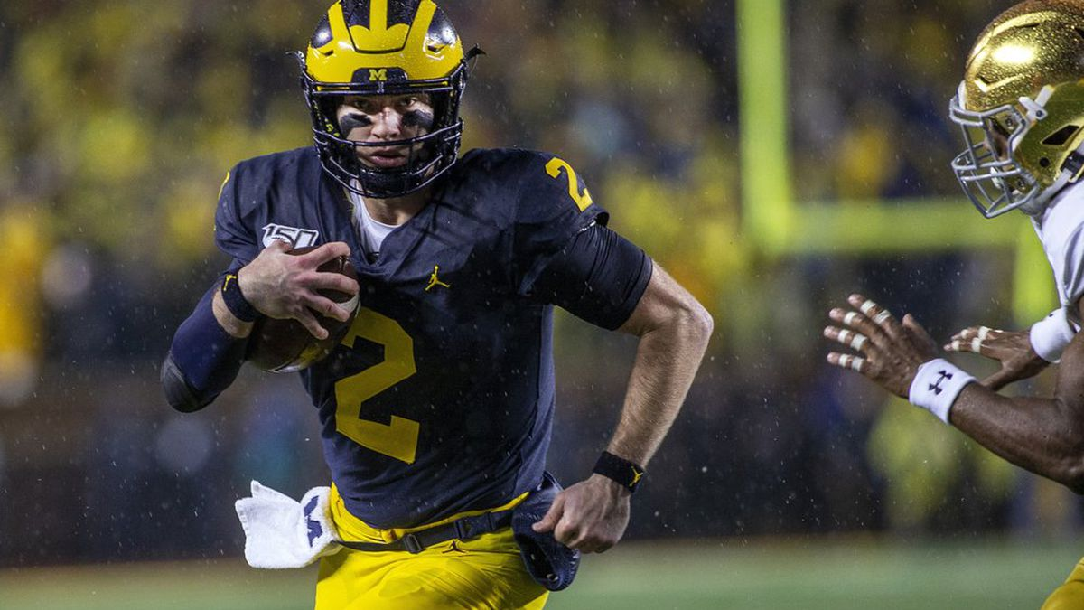 Michigan quarterback Shea Patterson (2) rushes in the second quarter of an NCAA college football game against Notre Dame in Ann Arbor, Mich., Saturday, Oct. 26, 2019. (AP Photo/Tony Ding)