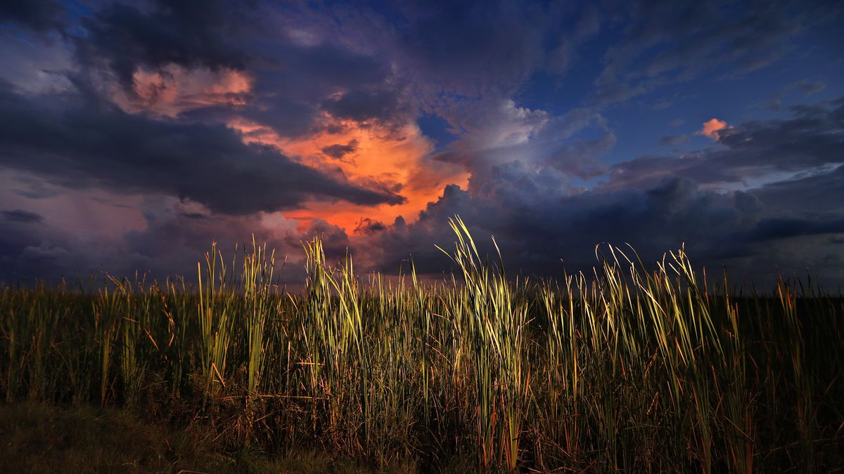 FILE - In this Oct. 20, 2019 photo, a clearing late-day storm adds drama in the sky over a...
