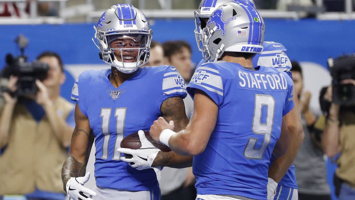 Detroit Lions wide receiver Marvin Jones (11) is greeted by quarterback Matthew Stafford (9)...