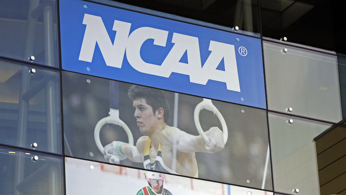 In this April 25, 2018, file photo, the NCAA headquarters is shown in Indianapolis. The NCAA is expected to approve a recommendation to all athletes who compete in fall sports, including football, over the next 10 months to not be charged a year of eligibility. It's great news for current players, but comes with some complications for teams, coaches and future college football players.