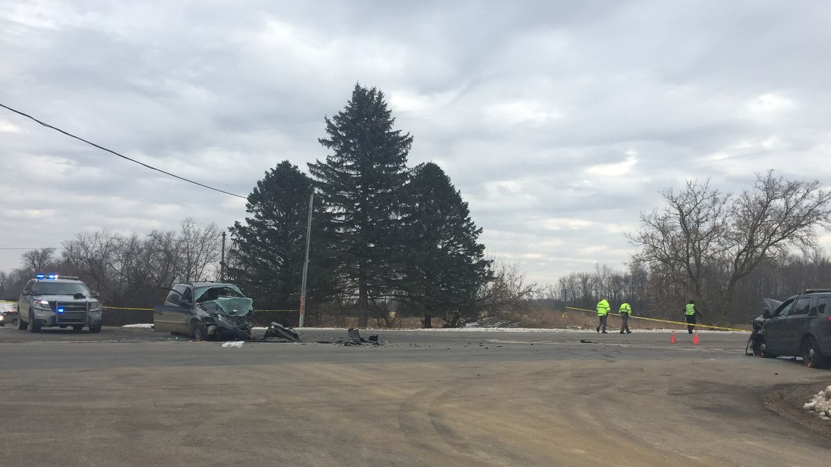 Officials are cleaning up an area where a DeWitt Township Police vehicle was struck by a minivan.   (Source WILX)